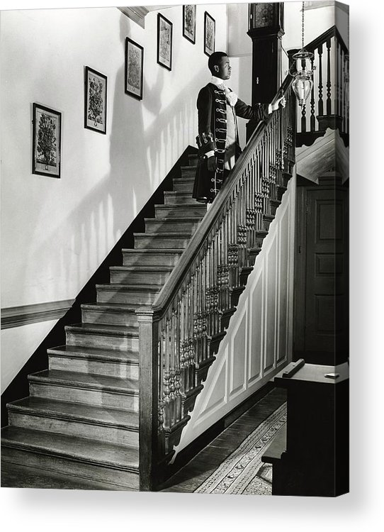 Antique Acrylic Print featuring the photograph Man Dressed As Colonial Butler On The Stair by George Karger