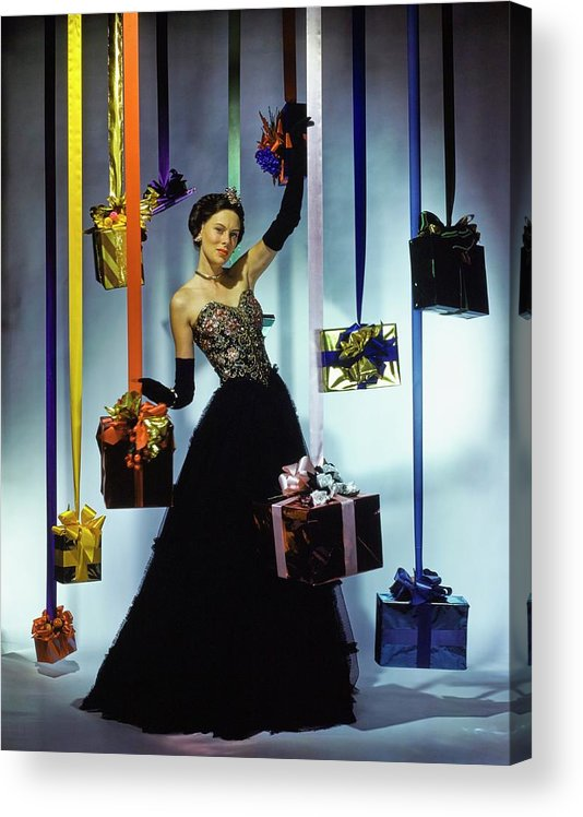 Accessories Acrylic Print featuring the photograph Model Wearing An Evening Gown Among Gifts by John Rawlings