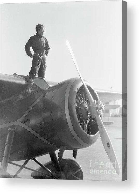 Amelia Earhart - Aviator Acrylic Print featuring the photograph Amelia Earhart Standing Atop Plane by Bettmann