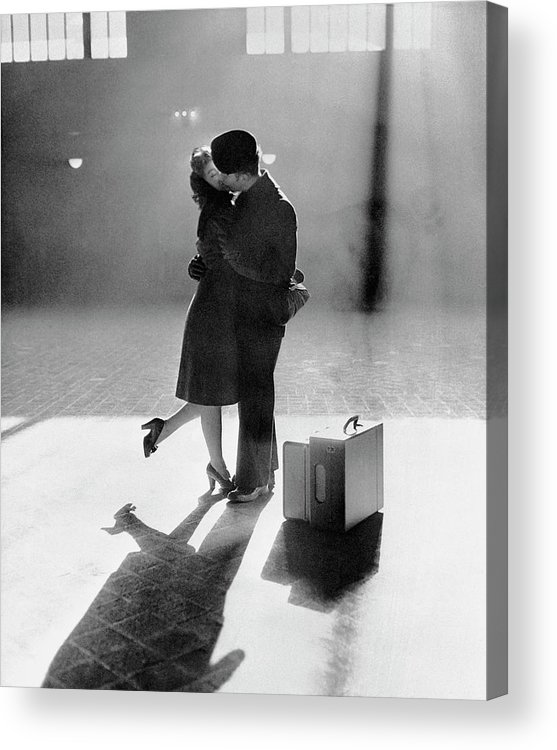 Shadow Acrylic Print featuring the photograph Couple Kissing In Train Station by Bettmann