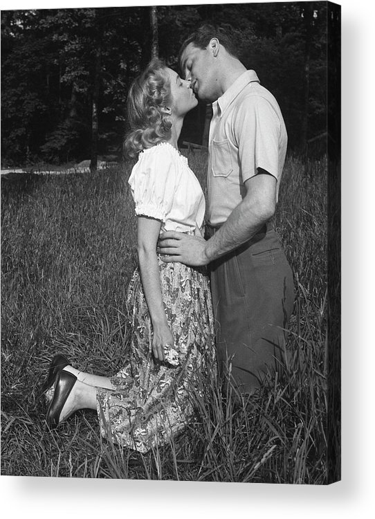 Heterosexual Couple Acrylic Print featuring the photograph Couple Kissing Outdoors by George Marks