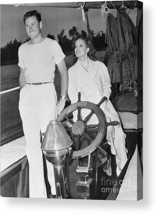 Lili Damita Acrylic Print featuring the photograph Errol Flynn And Lili Damita On Fishing by Bettmann