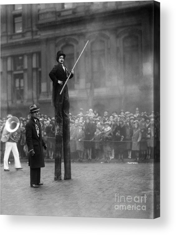 Crowd Of People Acrylic Print featuring the photograph Performer On Stilts by Bettmann