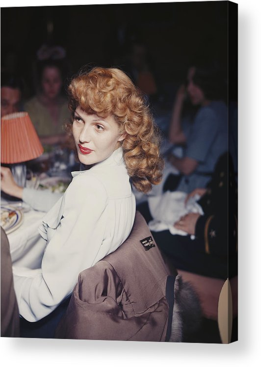 Looking Over Shoulder Acrylic Print featuring the photograph Rita Eats Out by Hulton Archive