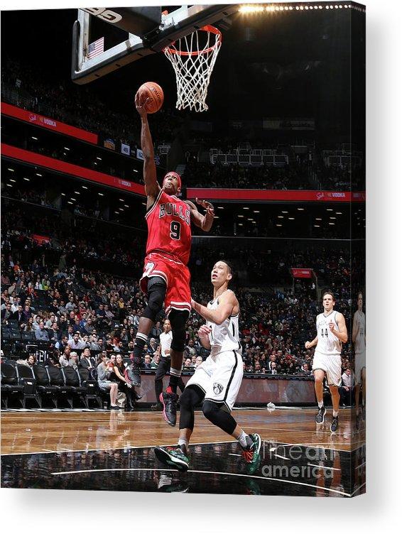 Nba Pro Basketball Acrylic Print featuring the photograph Rajon Rondo by Nathaniel S. Butler