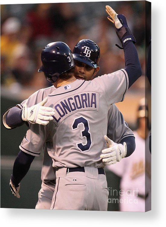 American League Baseball Acrylic Print featuring the photograph Carlos Pena and Evan Longoria by Jed Jacobsohn