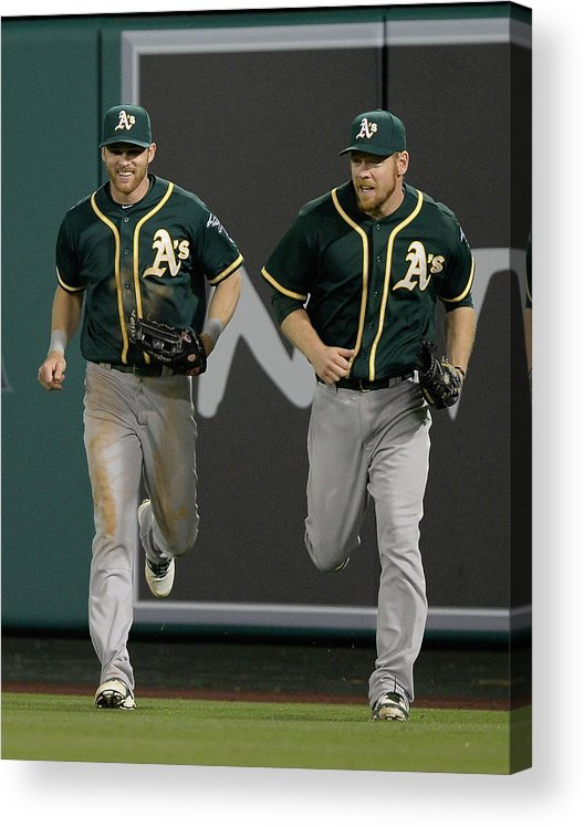 American League Baseball Acrylic Print featuring the photograph Derek Norris, Howie Kendrick, and Brandon Moss by Harry How