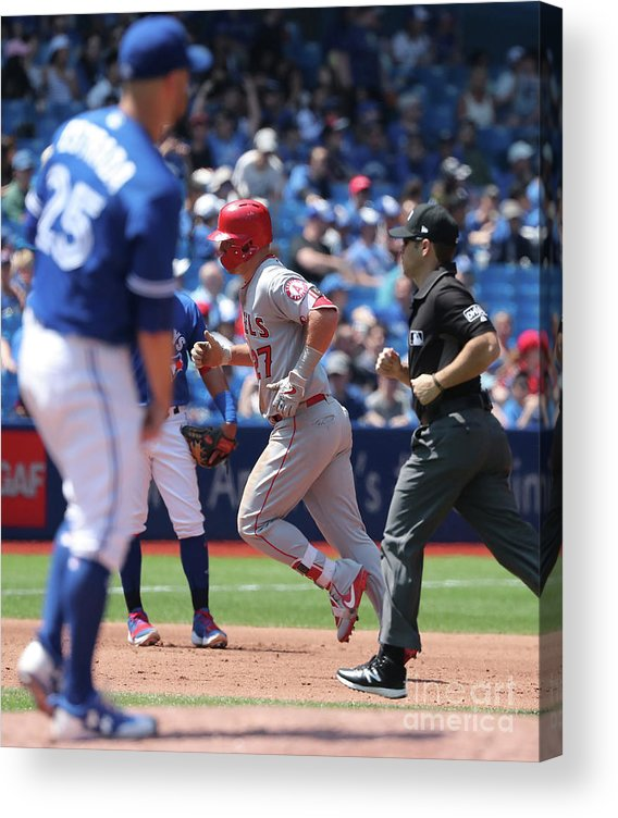 People Acrylic Print featuring the photograph Mike Trout and Marco Estrada by Tom Szczerbowski