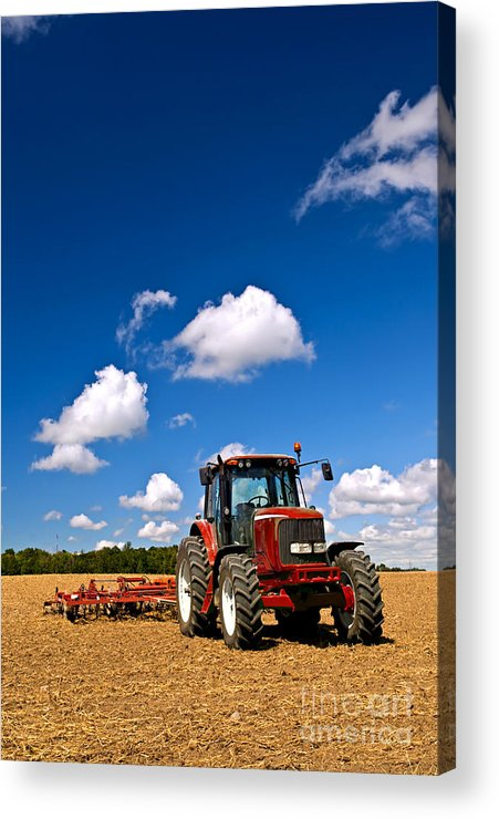 Tractor Acrylic Print featuring the photograph Tractor In Plowed Field by Elena Elisseeva