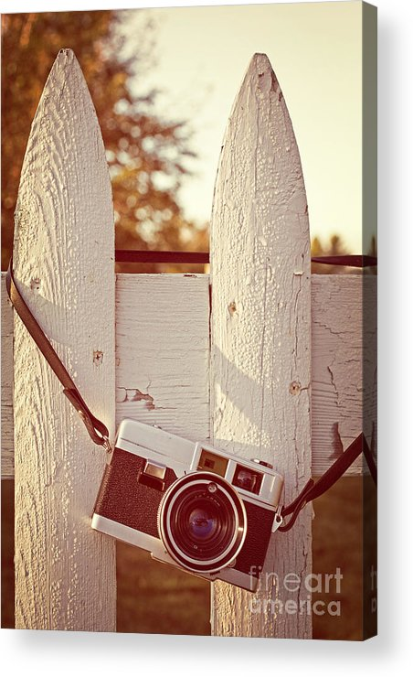 Sunrise Acrylic Print featuring the photograph Vintage Film Camera On Picket Fence by Edward Fielding