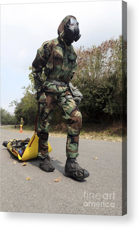 Exercise Cobra Gold Acrylic Print featuring the photograph Soldier Drags A Simulated Attack Victim by Stocktrek Images