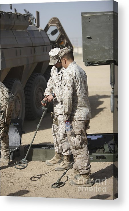 Explosive Ordnance Disposal Acrylic Print featuring the photograph Two U.s. Marines Use A Mine Detector by Terry Moore
