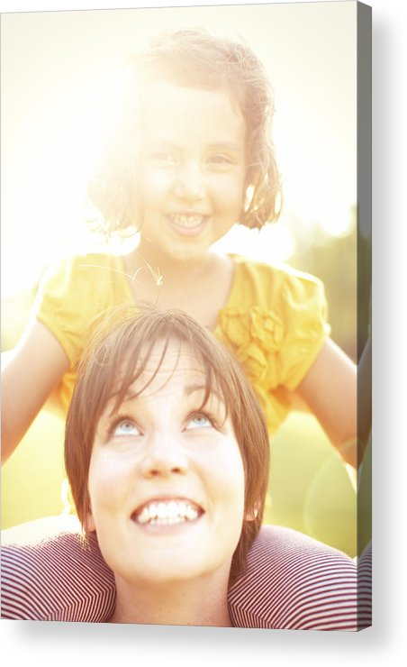 Adult Acrylic Print featuring the photograph Smiling Mother Holding Daughter by Gillham Studios
