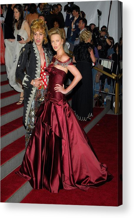 Anglomania Tradition And Transgression In British Fashion Opening Gala Acrylic Print featuring the photograph John Galliano, Charlize Theron Wearing by Everett
