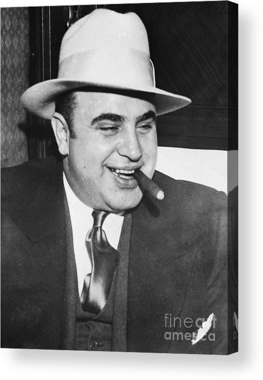 Al Capone Acrylic Print featuring the photograph Gangster Al Capone Smoking Cigar by Bettmann
