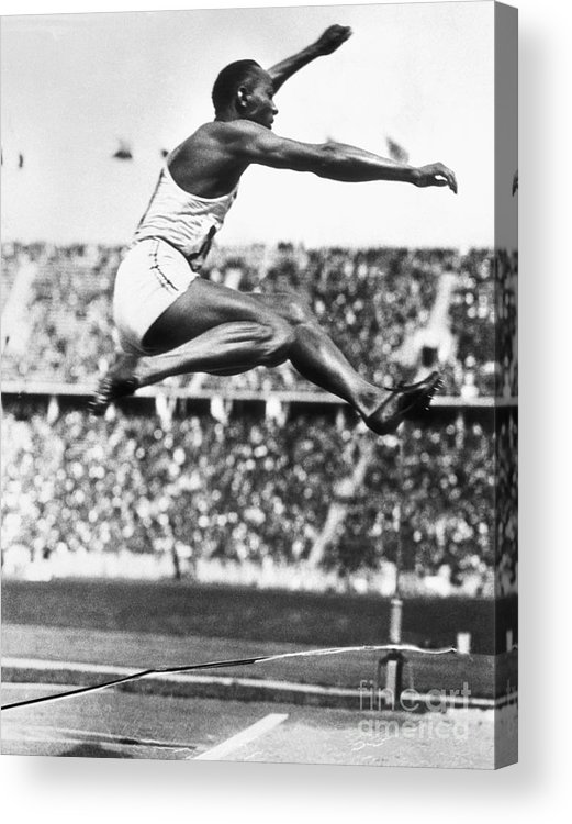 The Olympic Games Acrylic Print featuring the photograph Jesse Owens In Midair by Bettmann