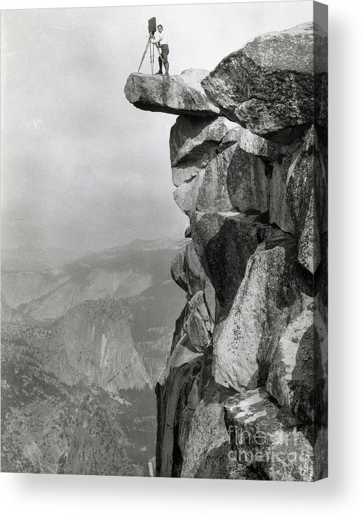 People Acrylic Print featuring the photograph Photographer Standing On Mountain Ledge by Bettmann