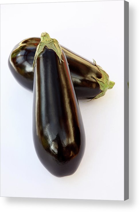 White Background Acrylic Print featuring the photograph Ripe, Organic Aubergines On White by Rosemary Calvert