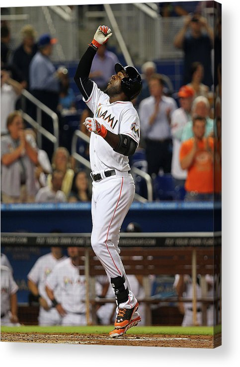 American League Baseball Acrylic Print featuring the photograph Marcell Ozuna by Mike Ehrmann
