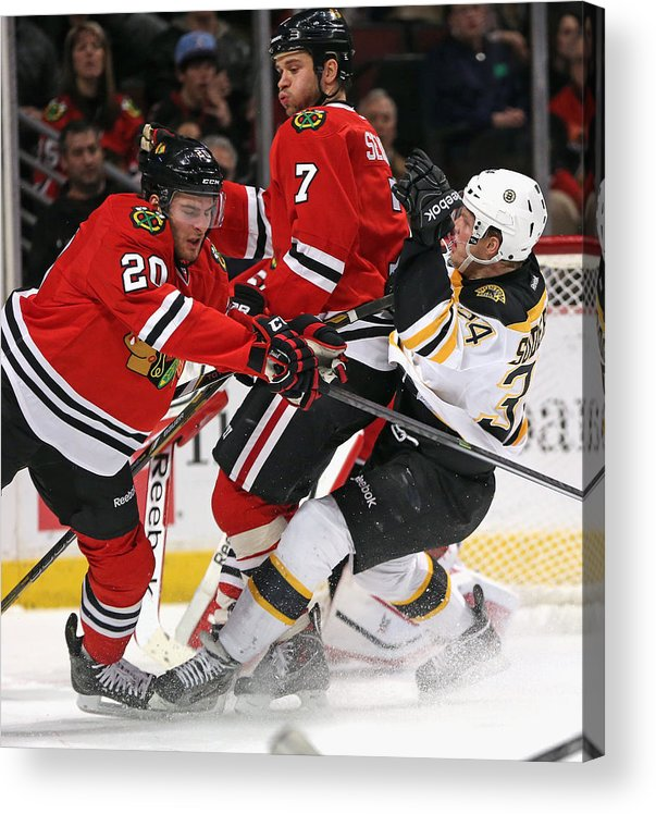 Brandon Saad Acrylic Print featuring the photograph Boston Bruins v Chicago Blackhawks by Jonathan Daniel