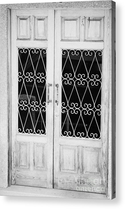 Europe Acrylic Print featuring the photograph double wooden doors with wrought iron decorative window guards Tenerife Canary Islands Spain by Joe Fox