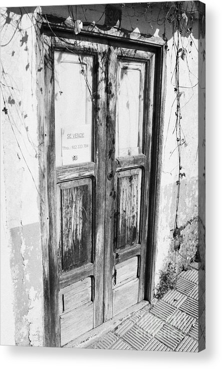 Europe Acrylic Print featuring the photograph old weathered brown wooden door entrance to abandoned house with cracked stucco walls and for sale sign in spanish in Tacoronte Tenerife Canary Islands Spain by Joe Fox