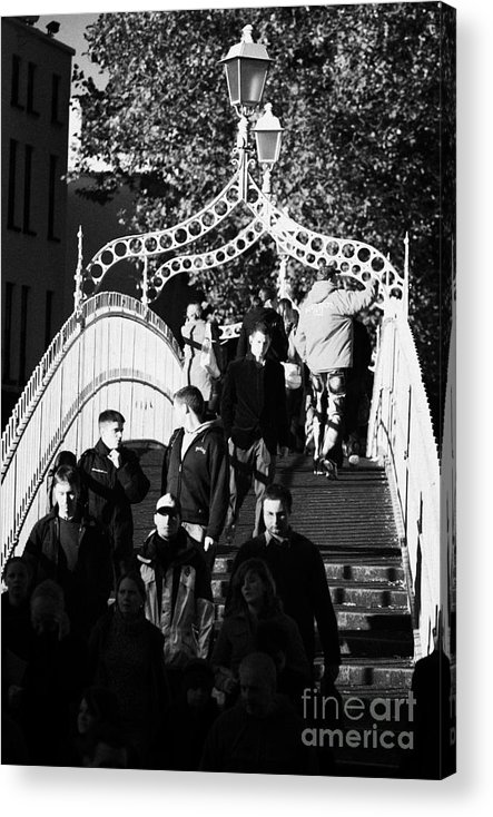 Dublin Acrylic Print featuring the photograph People Crossing The Hapenny Ha Penny Bridge Over The River Liffey In Dublin At A Busy Time Vertical by Joe Fox