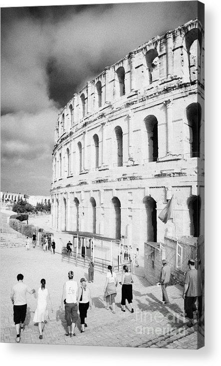 Tunisia Acrylic Print featuring the photograph Tourists Walk Down Steps Towards The Main Entrance Of The Old Roman Colloseum Against Blue Cloudy Sky El Jem Tunisia Vertical by Joe Fox