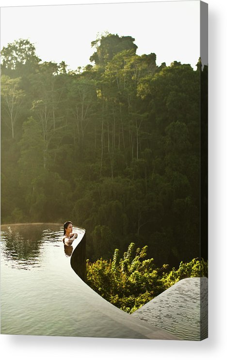 Tropical Rainforest Acrylic Print featuring the photograph Woman In Infinity Pool At Sunrise. Bali by Matthew Wakem