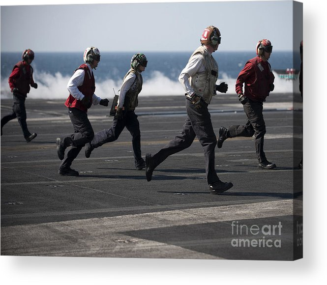 Warship Acrylic Print featuring the photograph Sailors Clear The Landing Area by Stocktrek Images
