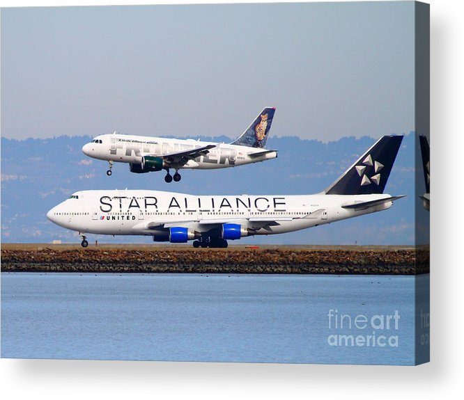 Airplane Acrylic Print featuring the photograph Star Alliance Airlines And Frontier Airlines Jet Airplanes At San Francisco International Airport by Wingsdomain Art and Photography