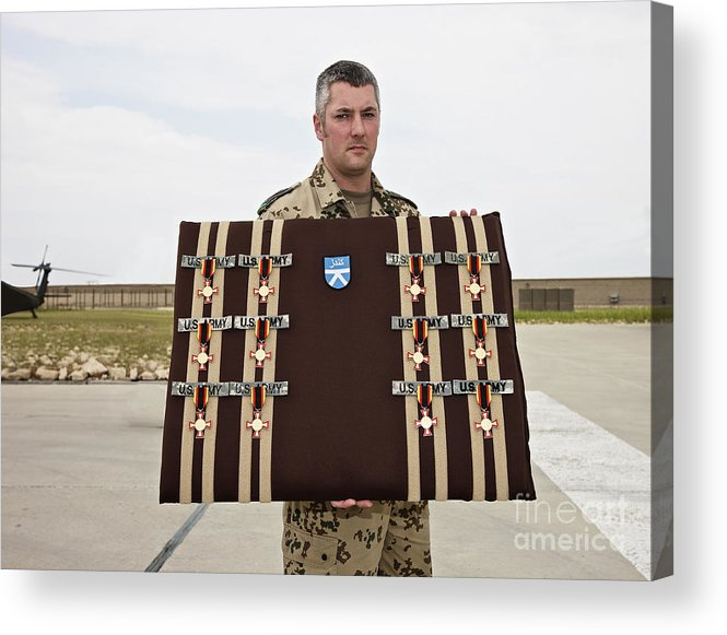 Afghanistan Acrylic Print featuring the photograph A German Soldier Holds A Display by Terry Moore
