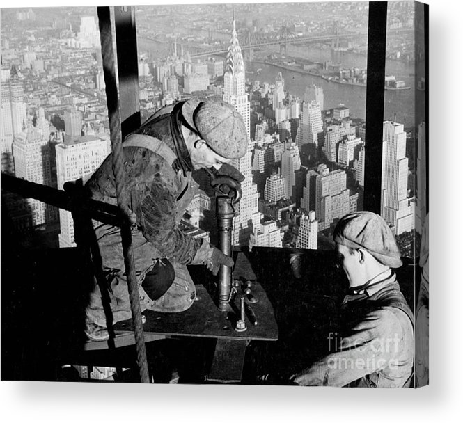 Riveters; Riveting; Male; Work; Labour; Workers; Working; Labourers; Construction; Building; History; Historical; Landmark; Skyscraper; High-rise; Empire State Building; 1930s; 30s; Thirties; Us; Usa; America; American; United States; High; Challenge; Risk; Danger; Courage; Bravery; Heights; Achievement; Scale; Teamwork; Chrysler Building; Aerial View; New York; Manhattan; Architecture; Urban; City; Cityscape; Dramatic; Builder; Builders; Scenic; Concentration; Black And White Photograph; B/w Photo; Photography Acrylic Print featuring the photograph Riveters On The Empire State Building by LW Hine