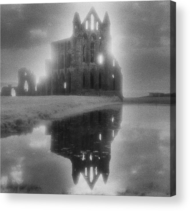 Eerie; Atmospheric; Spooky; Haunted; Haunting; Dramatic; Striking; Misty; Hazy; Lake; Reflection; English; Architecture; Exterior; Ruin; Ruins Acrylic Print featuring the photograph Whitby Abbey by Simon Marsden