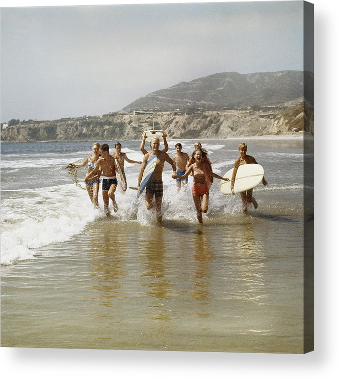 Young Men Acrylic Print featuring the photograph Group Of Surfers Running In Water With by Tom Kelley Archive
