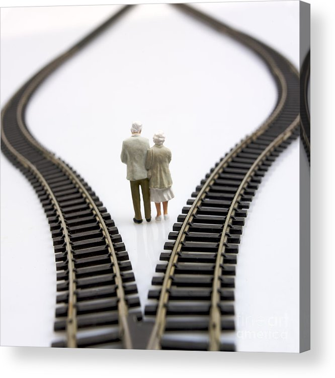 Contemplates Acrylic Print featuring the photograph Figurines Between Two Tracks Leading Into Different Directions Symbolic Image For Making Decisions. by Bernard Jaubert