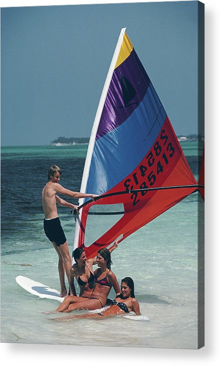 Young Men Acrylic Print featuring the photograph Bahamas Windsurfing by Slim Aarons