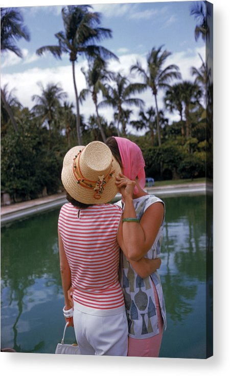 Lilly Pulitzer Acrylic Print featuring the photograph Poolside Secrets by Slim Aarons
