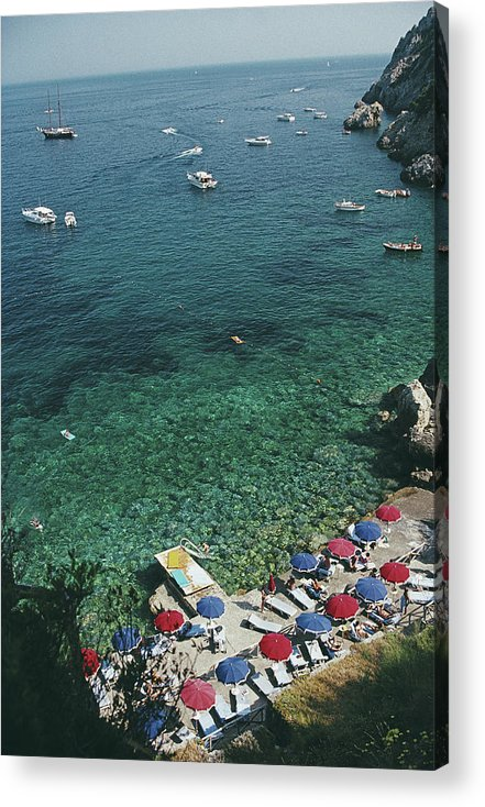 Sunbathing Acrylic Print featuring the photograph View From Il Pellicano by Slim Aarons
