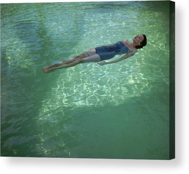 Exterior Acrylic Print featuring the photograph A Model Floating In A Swimming Pool by John Rawlings