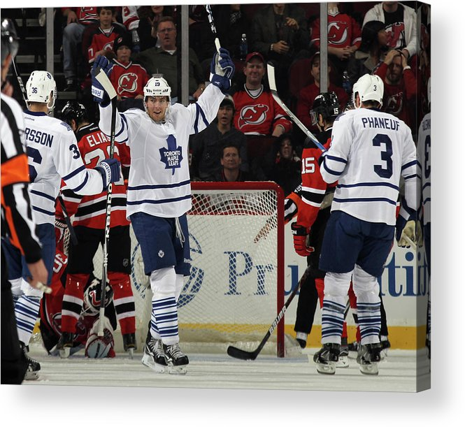 Scoring Acrylic Print featuring the photograph Toronto Maple Leafs V New Jersey Devils by Bruce Bennett