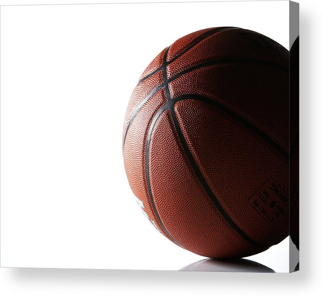 Recreational Pursuit Acrylic Print featuring the photograph Basketball On White Background by Thomas Northcut