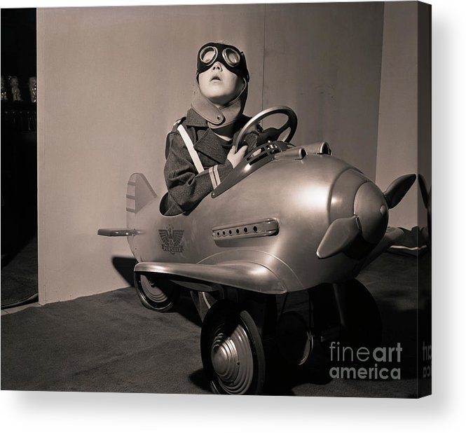 Child Acrylic Print featuring the photograph Boy In Aviator Suit Sitting In Toy Plane by Bettmann