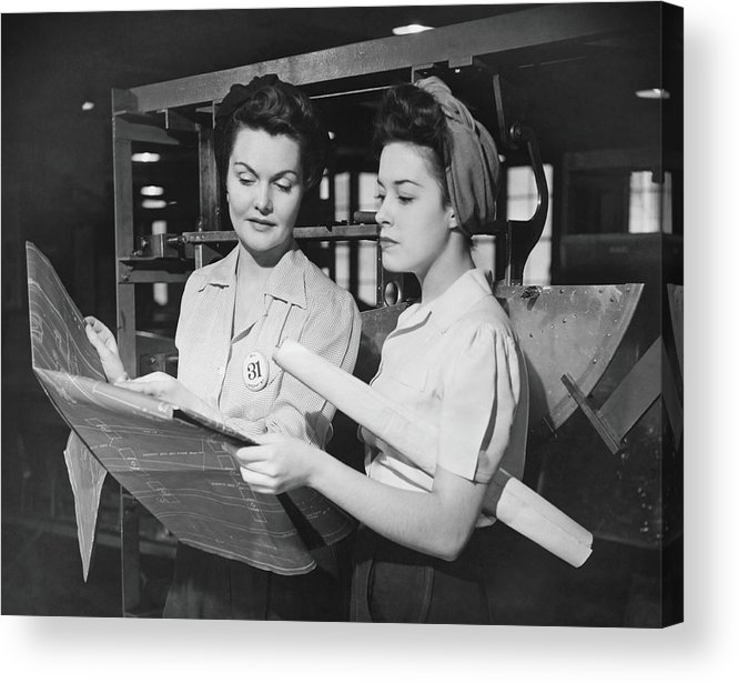 Plan Acrylic Print featuring the photograph Two Women In Workshop Looking At by George Marks