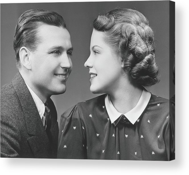 Young Men Acrylic Print featuring the photograph Young Couple Looking In Eyes In Studio by George Marks
