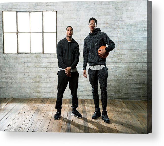 Nba Pro Basketball Acrylic Print featuring the photograph Demar Derozan and Kyle Lowry by Nathaniel S. Butler