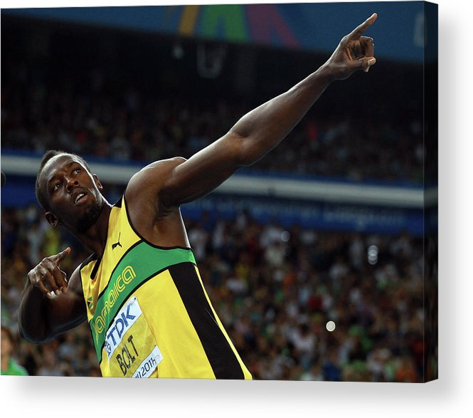 Usain Bolt 'to Di World' Pose Acrylic Print featuring the photograph 13th Iaaf World Athletics Championships by Alexander Hassenstein