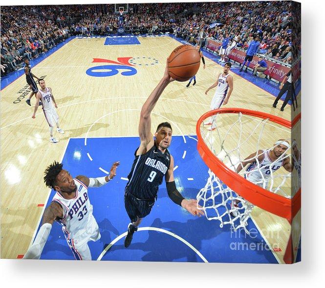 Nba Pro Basketball Acrylic Print featuring the photograph Philadelphia 76ers V Orlando Magic by Jesse D. Garrabrant