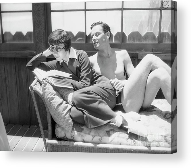 Norman Foster Acrylic Print featuring the photograph Claudette Colbert With Norman Foster by Bettmann