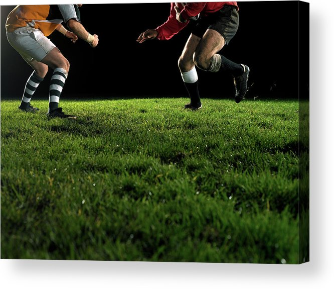 Grass Acrylic Print featuring the photograph Two Opposing Rugby Players, One Holding by Thomas Barwick